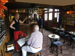Landlady Pat Ford chatting with a regular in the Bottom Bar at The Prince of Wales Pub Weybridge Surrey - Oatlands is between Weybridge and Walton-on-Thames Surrey
