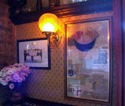 Sporting memorabilia and flowers at The Prince of Wales Pub Weybridge